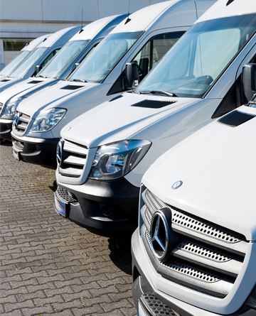 Fleet of white delivery vans