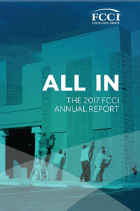 FCCI 2017 Annual Report cover - worker sputting up storn shutters